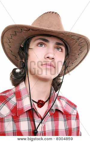 Thoughtful Young Man Holds A Cowboy Hat