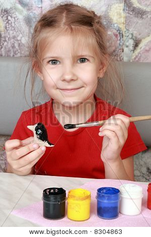 Smiling Girl Paints Crafts
