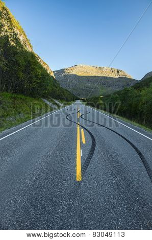 Burnout on deserted mountain road, Norway