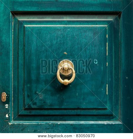 Dark Wooden Door Panel With Door Knocker.