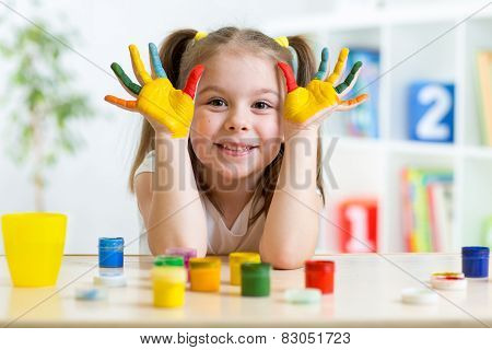 Portrait of kid girl with face and hands painted