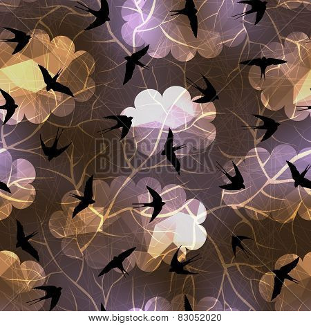 Swallows on night sky background.