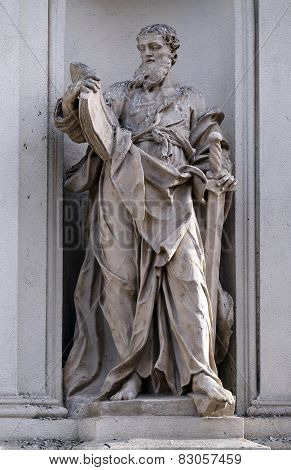GRAZ, AUSTRIA - JANUARY 10, 2015: Saint Paul the Apostle on the facade of Parish Church of the Holy Blood in Graz, Styria, Austria on January 10, 2015.