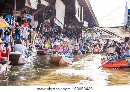 Vendor in floating market, Thailand