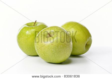 fresh green apples isolated on white background