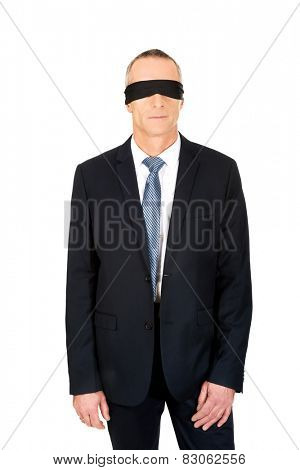 Businessman with band on eyes.