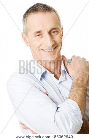 Good looking mature man touching shoulder.