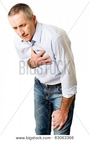 Mature man with heart disease bending.