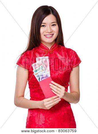 Chinese woman hold red pocket with RMB
