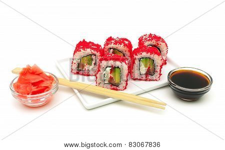 Rolls With Avocado, Salmon And Fish Roe On A Plate On A White Background