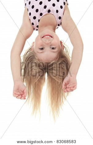 A Little with head upside down in studio