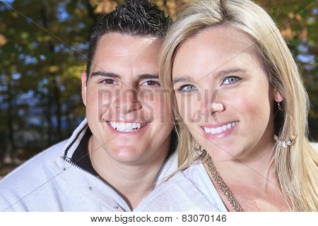 A happy autumn fall couple in nature