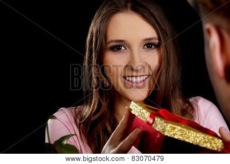 Happy woman recieving a gift on Valentines Day.