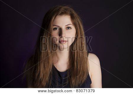 Studio Shot. Portrait Of Fashionable Model With Long Curly Ginger Red Hair And Natural Make-up