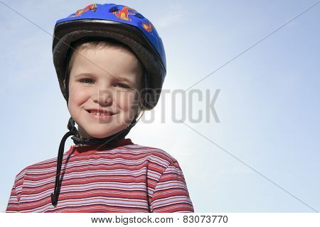 Boy having fun, rollerblading outdoor on a sunny summer day