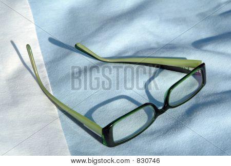 Eyeglasses on fabric background
