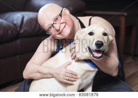 A 30 year sold woman with is dog in the living room.