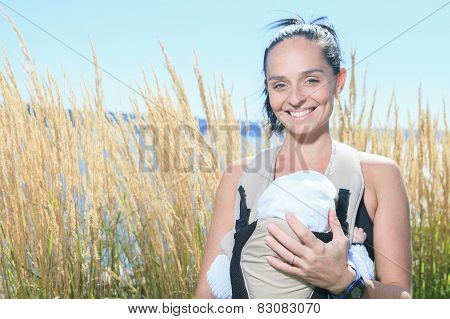 A Woman with little boy running outside