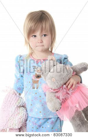 Little girl in pajamas  isolated on white background