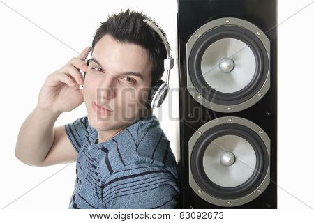 Portrait of a smiling male with headphones posing isolated on wh