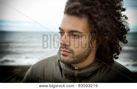 Sad Lonely Man Thinking In Front Of The Ocean In Winter