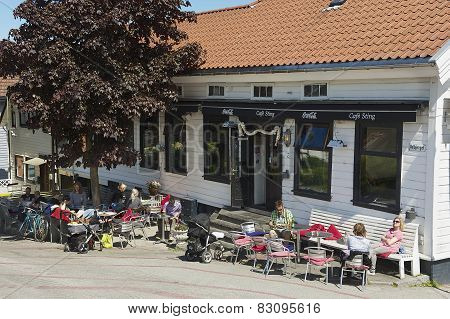 People relax in a street cafe in downtown Stavanger in Stavanger, Norway.
