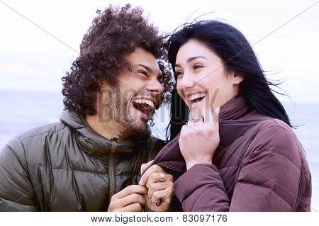 Happy Smiling Handsome Cool Man With Cute Girl In Front Of The Sea In Winter