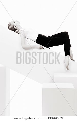 Fashionable female model posing at studio. Beauty, fashion photo. Clothing. Body care. Isolated over white.