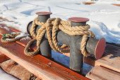 picture of bollard  - Mooring bollard on the old pier in winter - JPG
