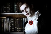 foto of dracula  - Handsome vampire nobleman studying ancient books in the library - JPG