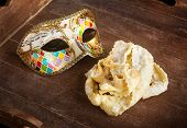 stock photo of frappe  - Typical fried pastry of italian carnival with venetian mask - JPG
