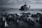 pic of shipwreck  - Old shipwreck long exposure on the rocks at sunset artistic conversion - JPG
