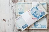 image of turkish lira  - Bunch of Turkish Lira over white wooden background - JPG