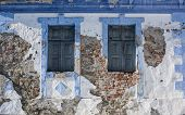 stock photo of jalousie  - Two classic jalousie windows in old house wall - JPG
