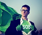 stock photo of sos  - Superhero Businessman Sos Word Concept - JPG