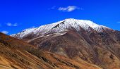 pic of jammu kashmir  - Rocky landscape of with ice peaks in background Ladakh Jammu and Kashmir India - JPG