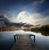 image of fool  - Fishing pier on a river under fool moon - JPG
