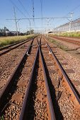 picture of intersection  - Train rail line tracks with cross over intersection - JPG