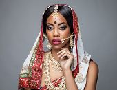 foto of indian wedding  - Exotic Indian bride dressed up for wedding ceremony - JPG
