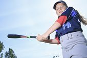 foto of hitter  - A Baseball girl hitter over a blue sky - JPG