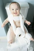 picture of disobedient  - Toddler ripping up toilet paper in bathroom - JPG