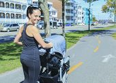 foto of buggy  - A Young mother jogging with a baby buggy - JPG