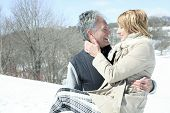 picture of 70-year-old  - Portrait of happy senior couple in winter season - JPG