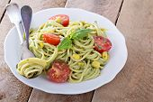 stock photo of avocado  - Vegan pasta with avocado sauce, tomatoes and corn