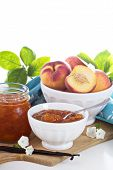 image of peach  - Peach vanilla jam with fresh peaches on table - JPG