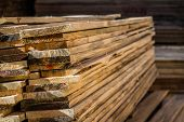 stock photo of timber  - Stacked wood pine timber for furniture production and construction - JPG