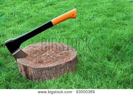 Modern Axe Set In Chopping Block Grass On The Background