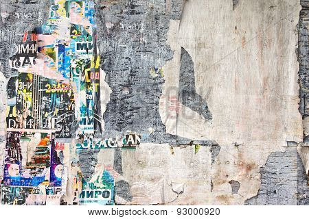 Old Weathered Wood Billboard With Torn Posters