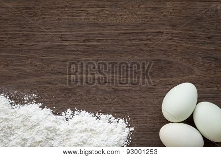 Baking Background, Eggs And Flour On Desk