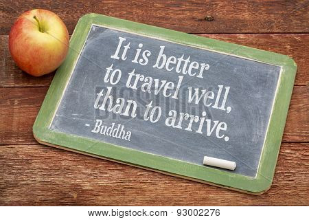 It is better to travel well than arrive  - Buddha quote  on a slate blackboard against red barn wood